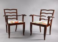 a pair of armchairs,