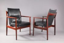 Pair of Arne Vodder black leather and rosewood arm...