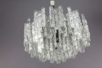 A tiered glass chandelier on a chrome frame by J.T...